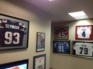 Dr Ekman's office was adorned with sports jerseys.