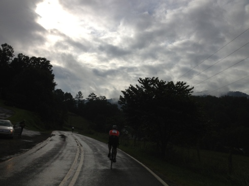 The sun peered through the clouds as we rode on rainy roads.