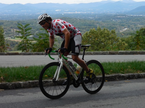 Chuck attacking the climb with the city of Roanoke behind him in the distance.